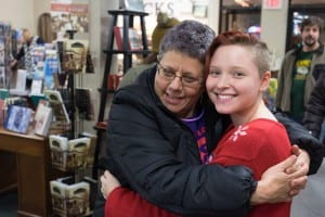 Edie hugging a customer at a store.